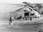 Soldiers disembark from a Wessex at San Carlos