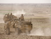 Members of the UKLF CSG Brigade Reconnaissance Force patrol in Jackal vehicles during a counter-IED operation in southern Helmand province