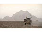 Members of the UKLF CSG Brigade Reconnaissance Force patrol in Jackal vehicles in southern Helmand province