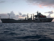 RFA Wavedressed overall for the Prince's visit, at anchor Barbuda, W.I. Late Oct/Nov 06.