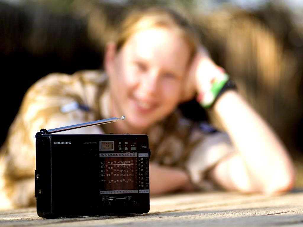 Woman listening to radio Iraq