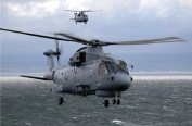 Two Merlin helicopters at sea