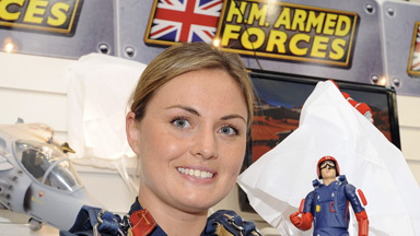 Flight Leuitenant Louise Buxton the Team Leader of the RAF Falcons Parachute Display Team holding a Falcon Toy.