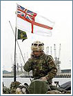 royal marine with british flag in background