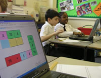 Two primary pupils using mathematics ICT resources and interactive teaching programs (ITPs) to learn mathematics.