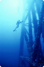 Diver working on oilrig underwater