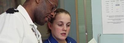 nurse looking at chart