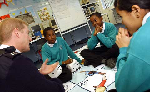 A police officer sits with three key stage 3 pupils during circle time