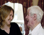 Carer laughing with older man