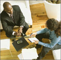 Homeowners Mortgage Support illustration of an adviser talking to a homeowner