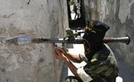 A Palestinian militant shoulders his rocket propelled grenade. © SAID KHATIB/AFP/Getty Images
