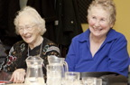 Photograph of two retired women at a social club