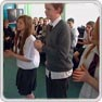 Three Formby High School pupils perform African dance in a circle of their peers