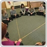 Pupils sat in a circle solving a maths problem