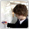Key stage 3 pupil contributes to mind map on whiteboard