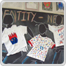 Pupils' work wall display featuring T-shirt designs on dancing figures
