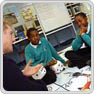 A police officer sits with two key stage 3 pupils during circle time