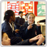 key stage 3 pupils assemble informally in a classroom