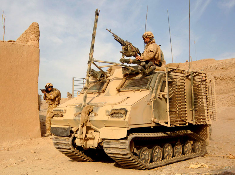 Royal Marines, escorted by a Viking armoured vehicle, patrol through the narrow streets of Gereshk (Archive picture)