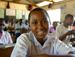 Photo of a pupil sitting at a desk in a Kenyan school