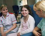 Nurses talking to young patient