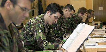 Army students are shown in a classroom undergoing Pashto language training