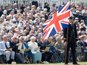 Veterans attend the Drumhead Ceremony at Southsea Common.