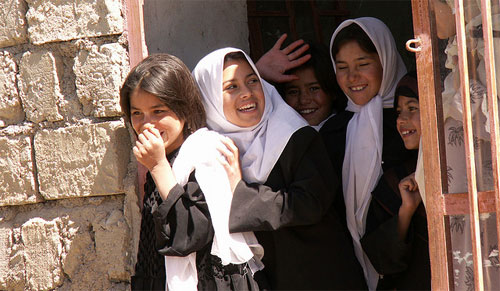 Girls at school in Afghanistan. Photo by Corporal Vilius Džiavečka, Lithuania. Flickr, Creative Commons.