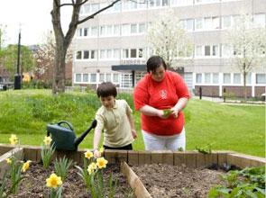 Residents gardening at Gambier House, Islington