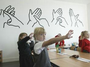 Sign language graphics on classroom wall at Dalry Primary School.