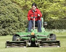 A green space trainee using a ride on gang mower in Capel Manor. Photo by Robert Gray.