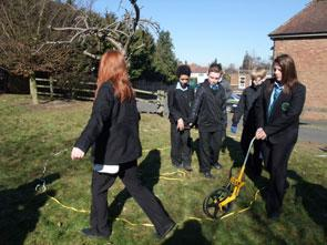 Students from Ercall Wood Technology College work with a local surveyor to design a spiritual garden in their school grounds.