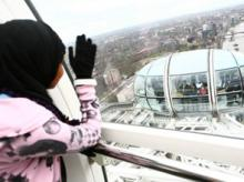 Girl looking out at the city from one of the pods on the London Eye