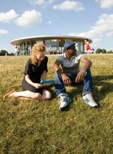 A man and woman sitting in a park