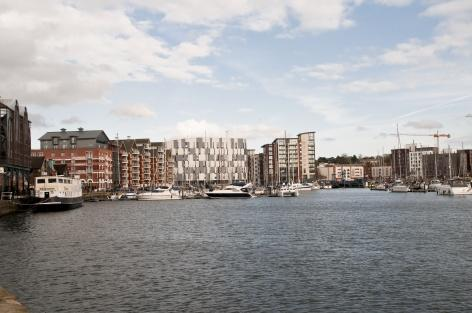 The new University Suffolk Waterfront Building overlooks Haven Marina. Photo by Haarala Hamilton