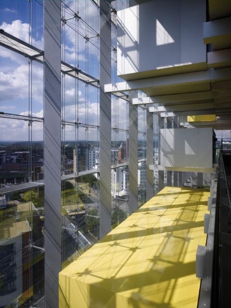 Brightly coloured pods protrude randomly into the glazed atrium space