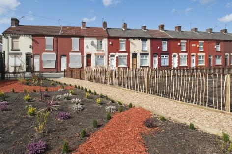 Cleared housing sites in the surrounding area have been given over to temporary uses, such as planting and informal public spaces.