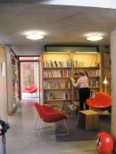 A welcoming and clearly defined library area provides a space for reading.