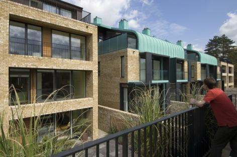 The townhouses on Brooklands Avenue each have a studio flat with a balcony overlooking the patio below