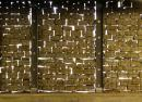 To allow daylight into sub-floor car parking at 'Glass' apartments (Feilden Clegg Bradley Architects), stone gabions are thin and provide a dramatic effect