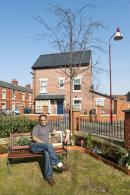 New street lighting and seating reinforces the distinctiveness of the neighbourhood