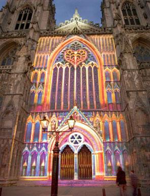 The York Minster plays a key part in the heritage of York. This image shows the Minster facade in lights as part of the annual 'Illuminating York' event