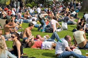 A busy Soho Square in the summer