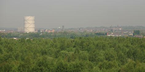 St Helens 'Town in the Forest': distant view northwards to St Helens town centre from the Sutton Manor reclaimed colliery site which has been turned into a country park