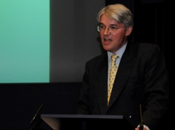 Andrew Mitchell delivers his speech at Oxfam's 21st Century Aid report launch event, at the Royal Society in London. Photo: DFID