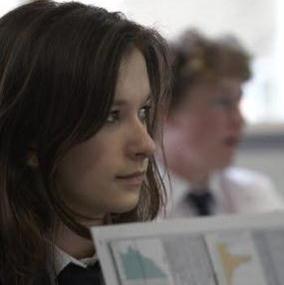 Teenage girl holding book