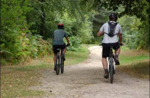Image showing cyclists on a path through some countryside