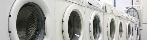 A row of domestic washing machines