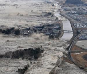 Earthquake-triggered tsumanis sweep shores along Iwanuma in northern Japan, PA copyright