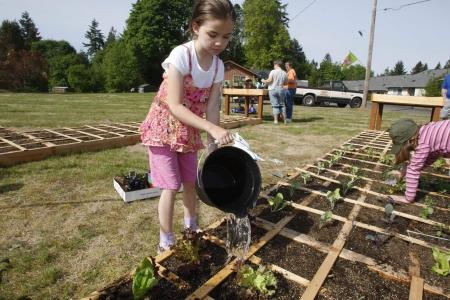 Little girl working in the garden